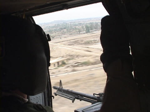 A military helicopter flies over Iraq Footage