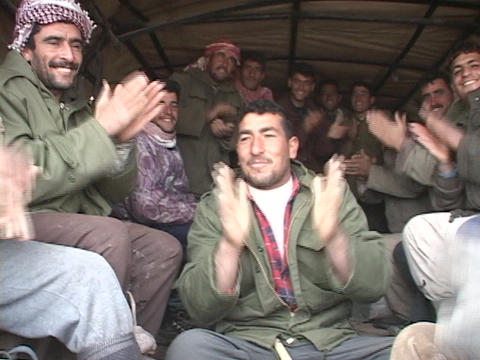 Iraqi workers clap their hands and celebrate in the back... Stock Video Footage