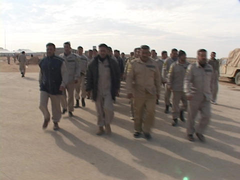 Iraqi troops march along a road on the military base Stock Video Footage