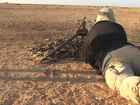 A U.S. soldier fires a machine gun in combat Stock Video Footage
