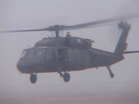A Black Hawk helicopter flies over Iraq Footage