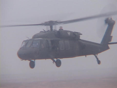 A Black Hawk helicopter flies over Iraq Stock Video Footage