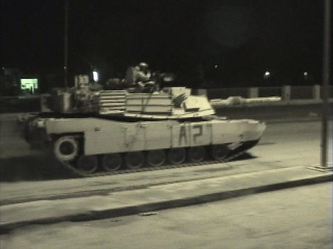 Abrams tanks speed through streets in Iraq Stock Video Footage