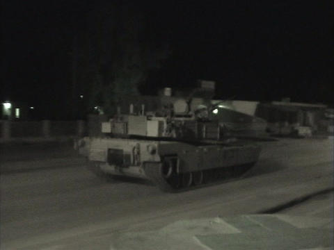 Abrams tanks speed through streets in Iraq Footage