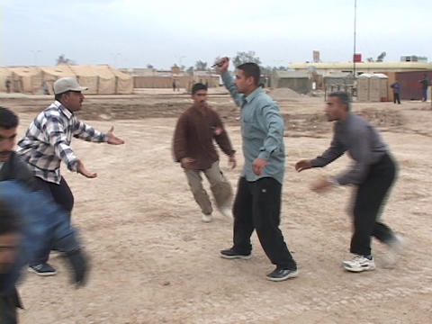 An Iraqi man attacks another man with a knife at a school... Stock Video Footage