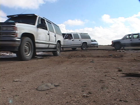 A convoy of armored trucks crosses the border between... Stock Video Footage