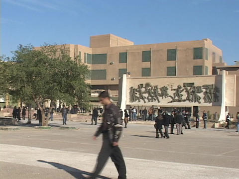 Students walk through the campus of a school in Baghdad Stock Video Footage