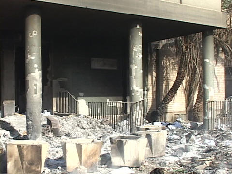 Charred remains smolder at a building in Baghdad Stock Video Footage