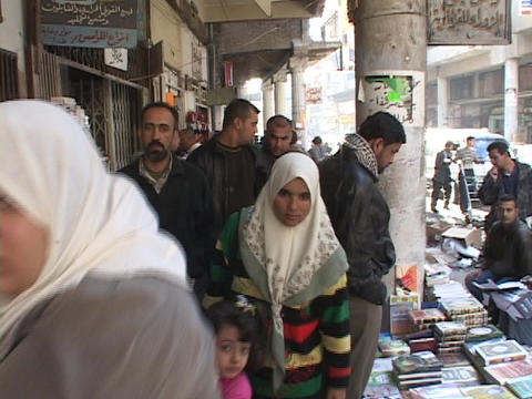 crowds of people walk along the streets of Baghdad Stock Video Footage
