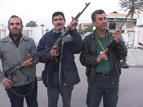 Iraqi men proudly pose with their weapons in Baghdad, Iraq Stock Video Footage
