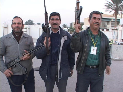 Iraqi men proudly pose with their weapons in Baghdad, Iraq Footage