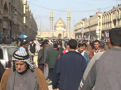 Iraqis walk and shop in a busy outdoor market of Baghdad,... Stock Video Footage