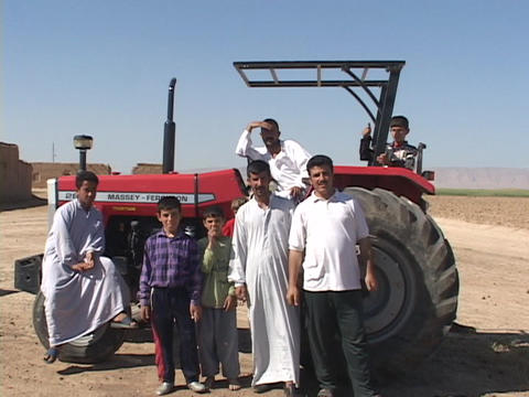 Kurdish farmers give a thumbs-up sign while posing on their tractor in Iraq Footage