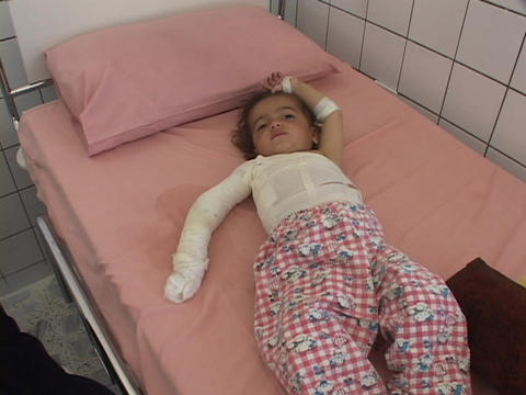An Iraqi mother tends to her injured baby in a hospital.The casualties of war Footage