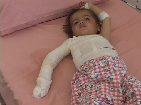 An Iraqi mother tends to her injured baby in a... Stock Video Footage
