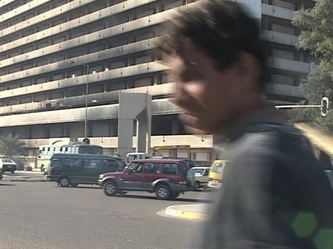 Traffic passes by the burned out Ministry Building in worn-torn Baghdad, Iraq Footage