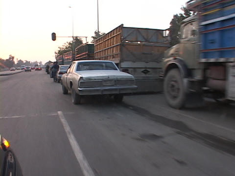 Iraqis push their cars while they wait for gas in Baghdad Footage