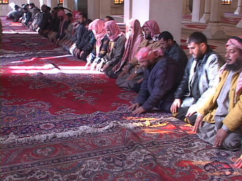 Muslims pray in a mosque of war-torn Baghdad, Iraq Stock Video Footage