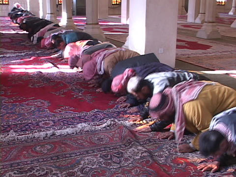 Muslims pray in a mosque of war-torn Baghdad, Iraq Footage