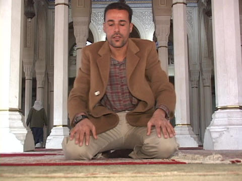 An Iraqi Muslim prays in a mosque of Baghdad Footage