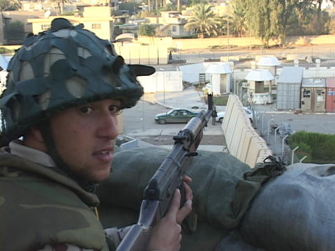 A soldier mans a guard post overlooking Baghdad, Iraq Stock Video Footage