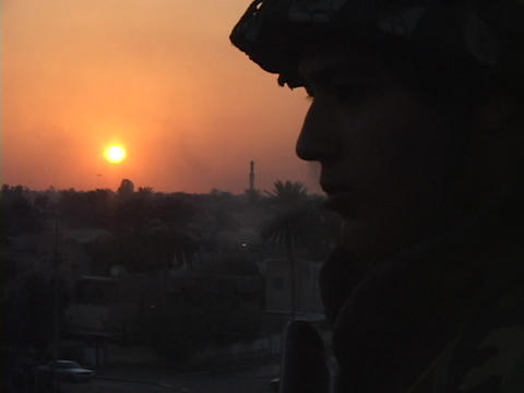 A soldier smokes a cigarette while manning a guard post... Stock Video Footage