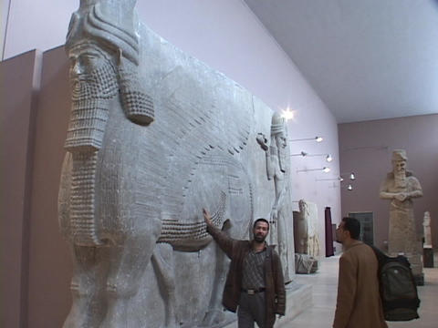 An Iraqi man looks at a Mesopotamian relic in the Baghdad... Stock Video Footage