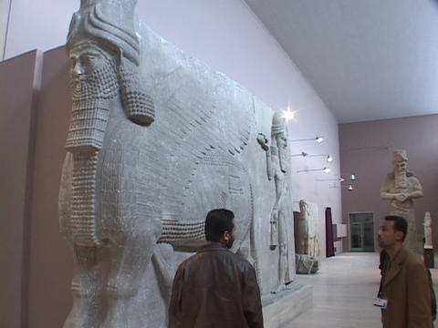 An Iraqi man looks at a Mesopotamian relic in the Baghdad Museum Footage