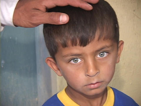 A young Iraqi boy shows the effects of war in his sad face Stock Video Footage