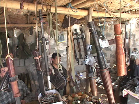 Weapons dealers work in their arsenal in Northern Iraq Stock Video Footage