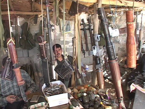 Weapons dealers work in their arsenal in Northern Iraq Footage