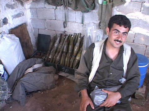 A weapons dealer in Northern Iraq proudly poses with his... Stock Video Footage
