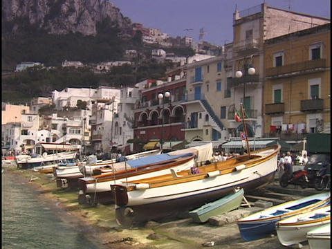 Fishing boats line the shore in the Isle of Capri Stock Video Footage