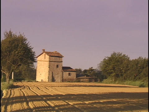 An Italian farmhouse sits next to fields Footage