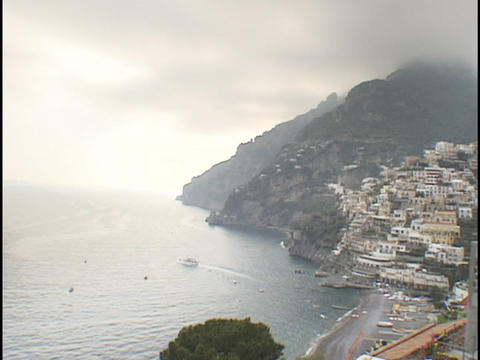 Fog rolls into the village of Positano Stock Video Footage