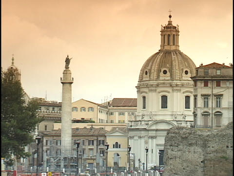 The Forum of Augustus towers next to Trajan's Column in Rome Stock Video Footage