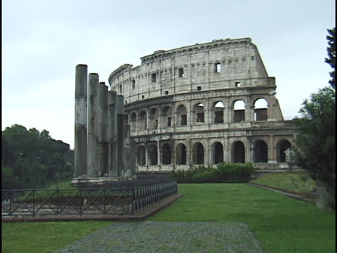 The ancient Coliseum towers over the city of Rome Footage