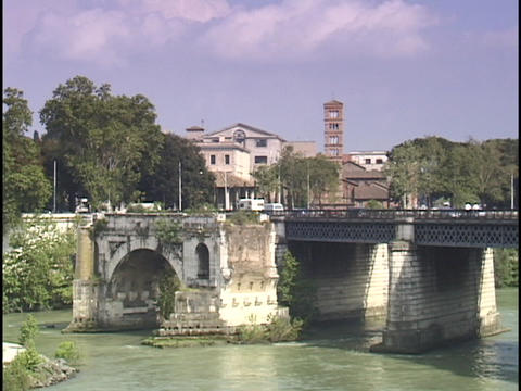Traffic crosses a bridge over the Tiber River Stock Video Footage