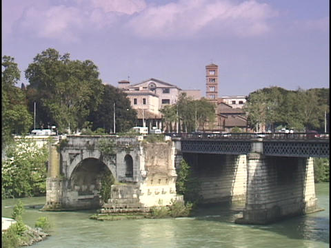 Traffic crosses a bridge over the Tiber River Footage