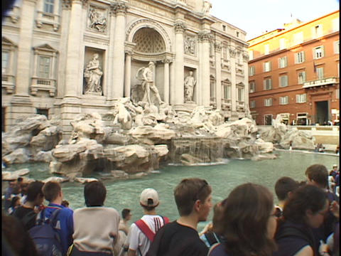 Tourists gather around the historic Trevi fountain in Rome Stock Video Footage