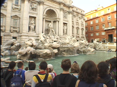 Tourists gather around the historic Trevi fountain in Rome Footage