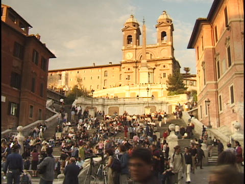 A crowd of visitors climbs and descends the Spanish steps in Rome, Italy Live Action