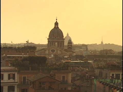 A stone cathedral rises above the skyline of Rome, Italy Footage