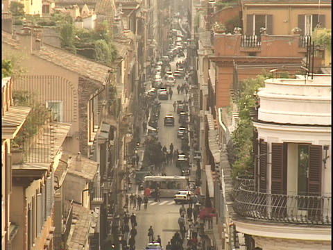 Terraced rooftops overlook a narrow street in Rome, Italy Stock Video Footage