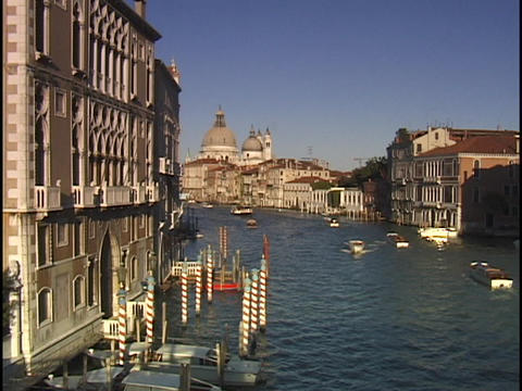 Small boats cruise up and down the Grand Canal in Venice Stock Video Footage