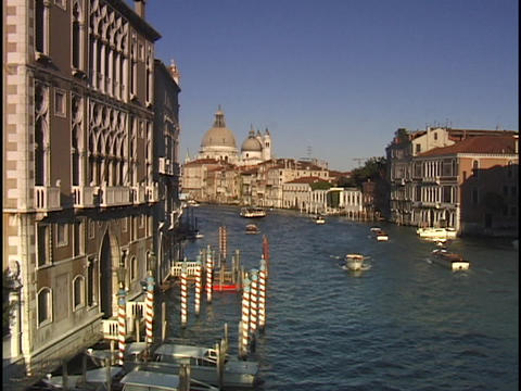 Small boats cruise up and down the Grand Canal in Venice Footage