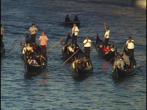 Tourists ride gondolas through the Grand Canal in Venice, Italy Live Action