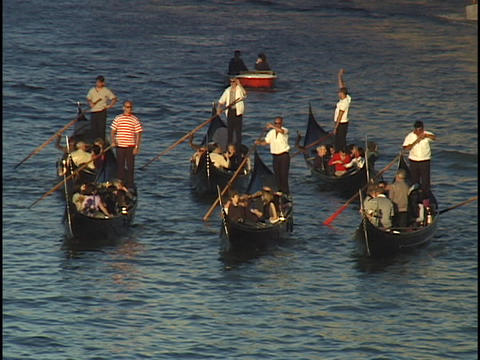 Tourists ride gondolas through the Grand Canal in Venice,... Stock Video Footage