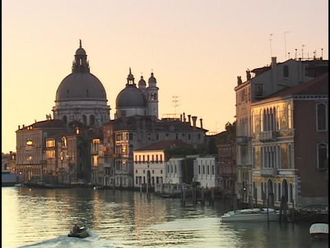 A small boat motors through the Grand Canal and past the... Stock Video Footage