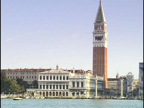 The tower of St. Mark's Square stands majestically above the Grand Canal in Venice, Italy Footage